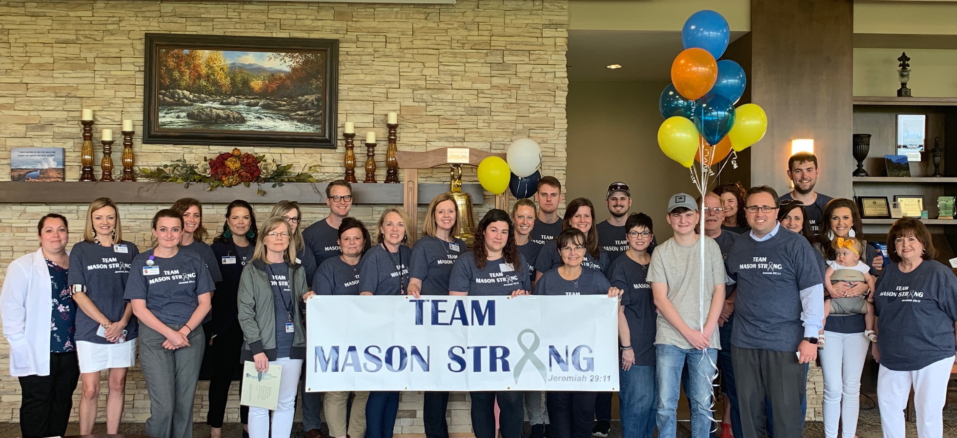 Mason Strong graduates after completing proton therapy treatment at Provision CARES