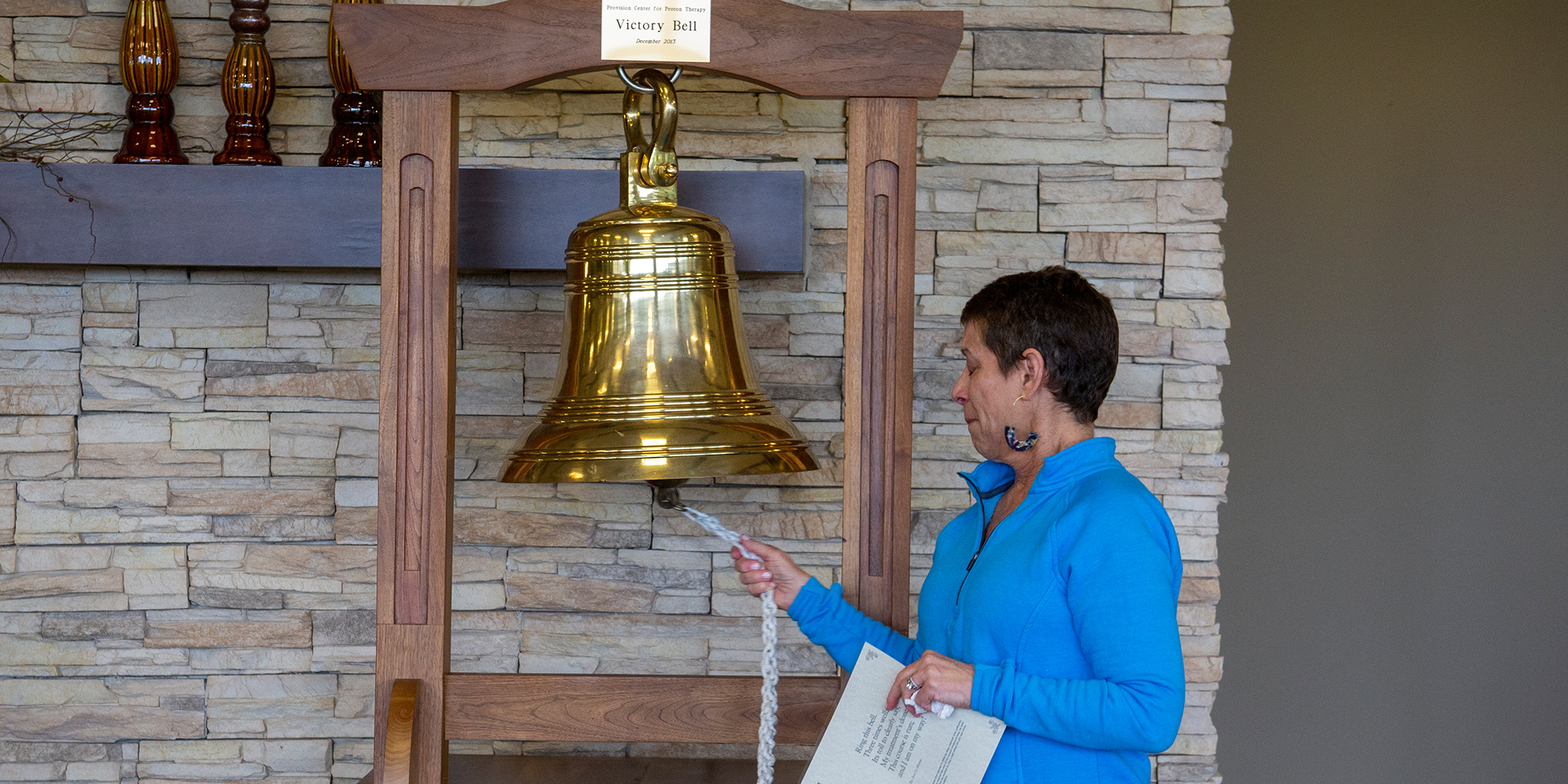 Casey rings the victory bell after completing breast cancer treatment at Provision CARES Proton Therapy Knoxville
