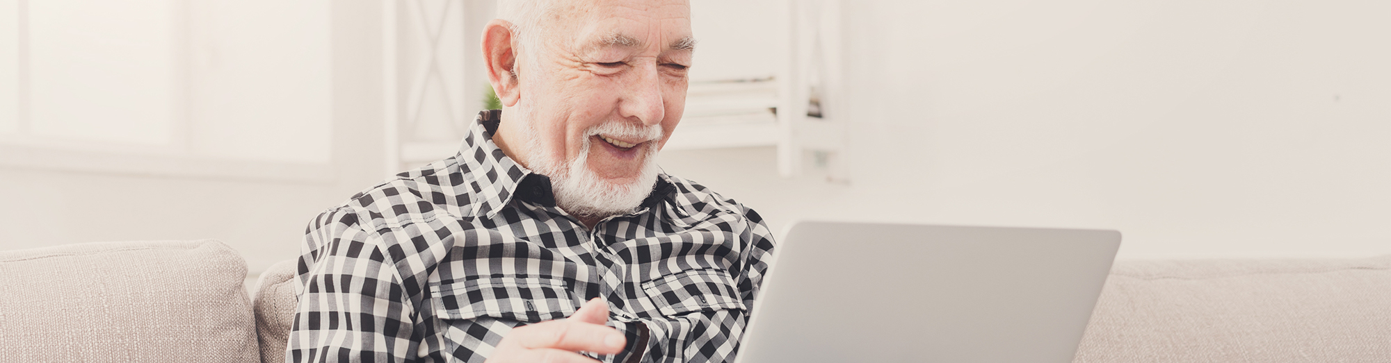 Male cancer patient using telehealth