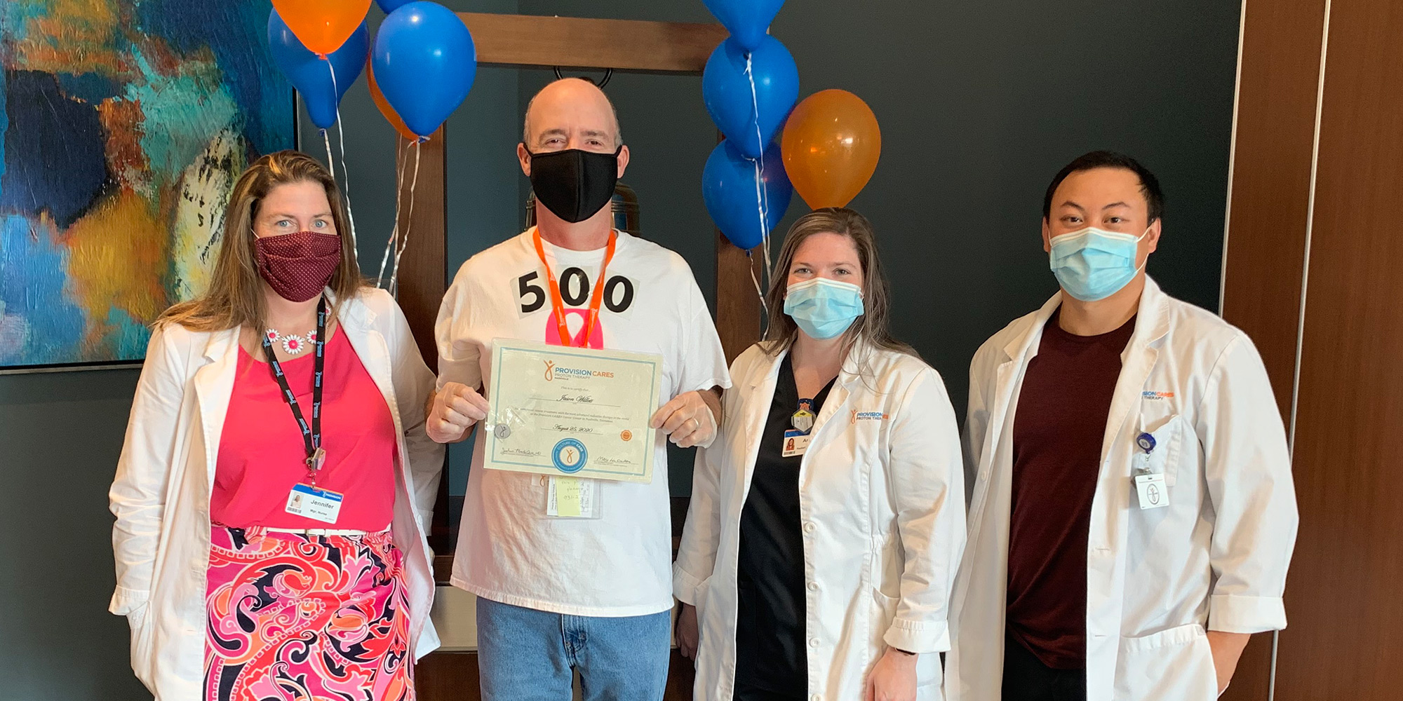 Team members from Provision CARES Proton Therapy Nashville pose with the 500th graduate
