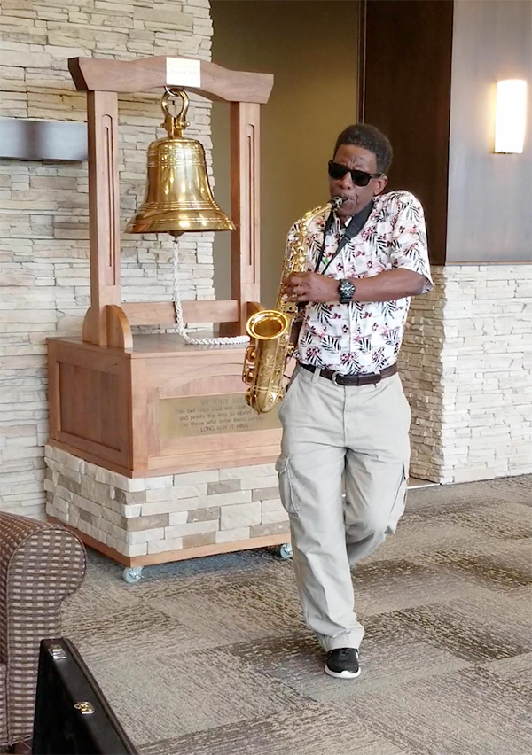James plays his saxophone after completing proton therapy treatment for prostate cancer at Provision CARES